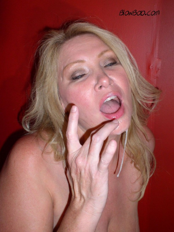Blonde milf covered in cum.