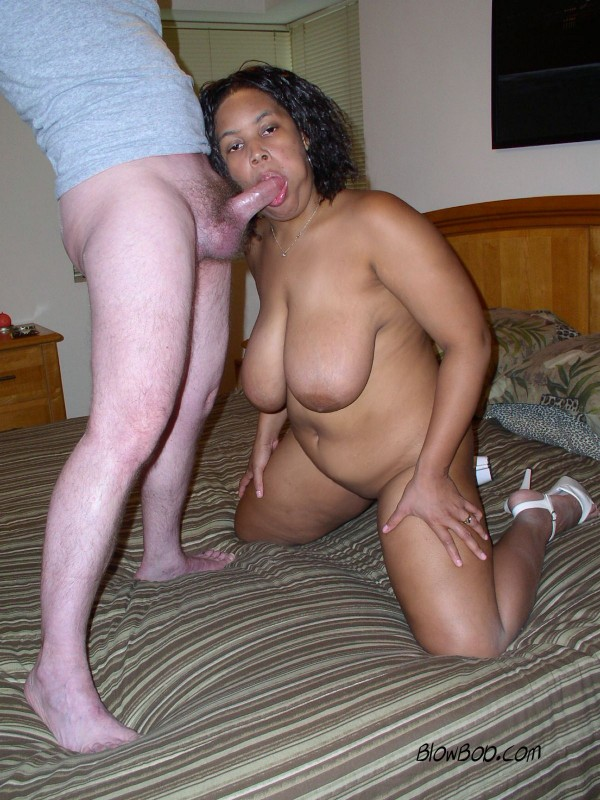 Big boob ebony milf is naked, wearing only high heels and sucking dick.
