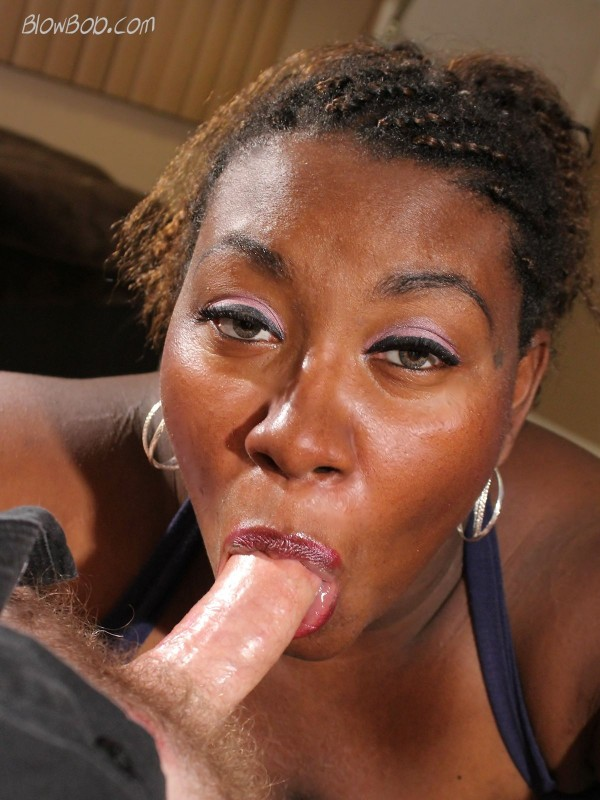 Thick lipped black chick sucks a big white cock.