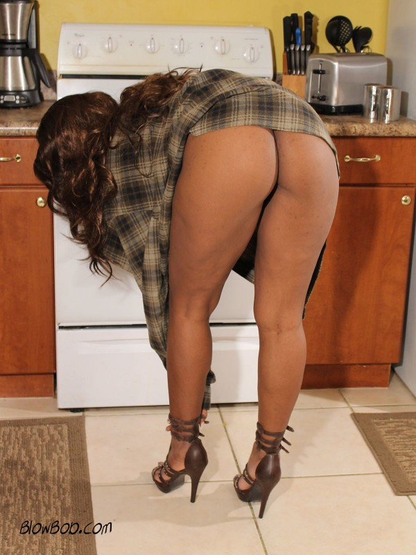 High heeled, big booty ebony wife bends over a hot stove and reveals the crack of her tight ass.